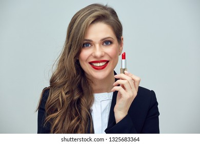 business woman with curly hair holding red lipstick. isolated studio portrait.