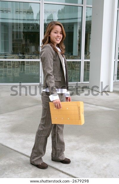 A business woman delivering an envelope of office mail