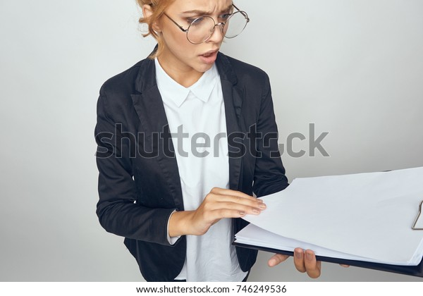 business woman with documents on a light background