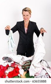 Business woman doing laundry and making funny face