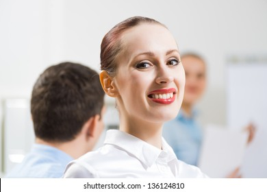 business woman doing a report next presentation boards, listening to her colleagues