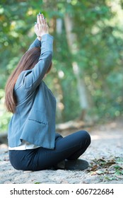 Business woman doing yoga meditation for relaxing, feel peace of mind and rest in the park.