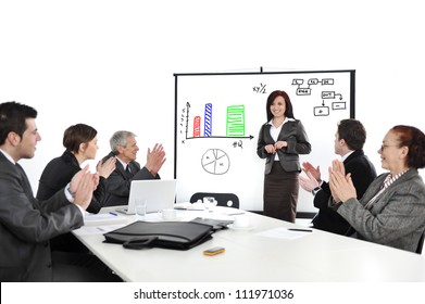 Business woman drawing a diagram during the presentation and receiving applause