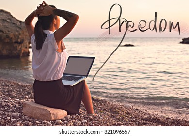 Business woman dreaming of freedom and rest on the beach near the sea. Picture of working day downshifting girl on beach by the sea on the background of the beautiful nature of the beach and the sea.