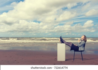 Business woman is dreaming on the beach sitting on a chair.