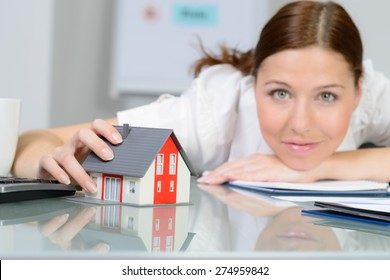 business woman dreams about new home