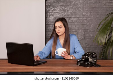 business woman drinking coffee, copy space behind her back