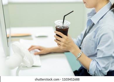 Business woman drinking ice coffee