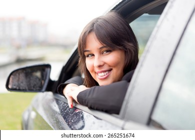 Business woman driving her new sports car