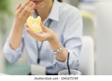Business woman eating cake