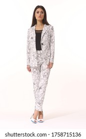 business woman executive in floral printed summer white pant suit - jacket and trousers