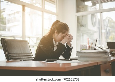 Business woman feeling stress from work in the office