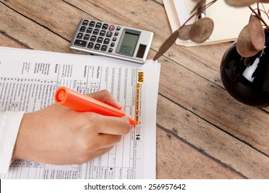 business woman filing federal income tax form 1040
