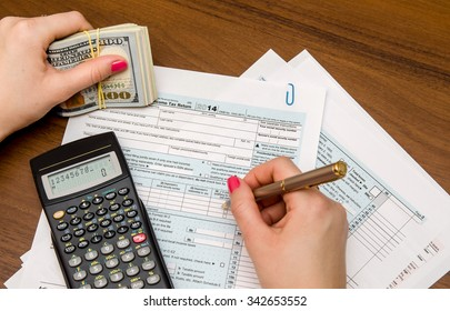 Business Woman Filling the Tax Form 1040