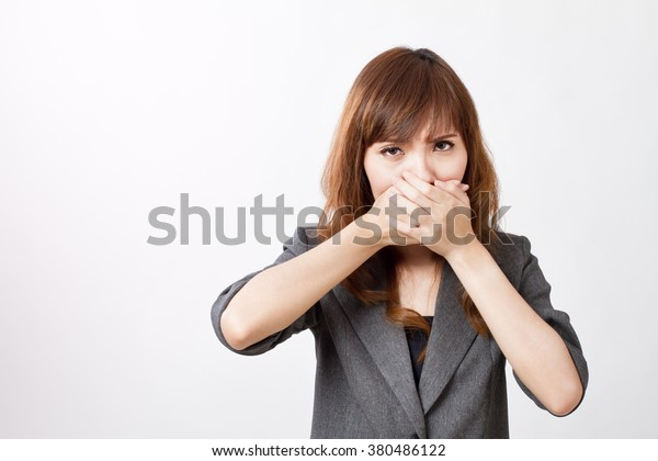 business woman firmly covering her mouth
