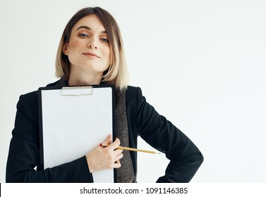 Business woman with a folder for documents in her hand and a pencil