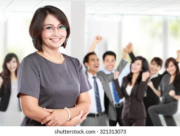 business woman in front of her team member, celebrating their success