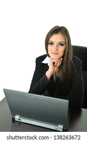 Business Woman in Front of Laptop with Hand on Chin