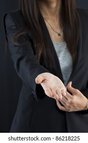 Business woman gives a handshake