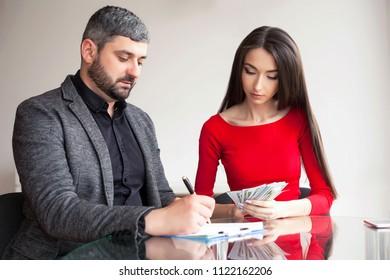 Business. Business Woman Gives Money to Men. Woman Dressed in Red Dress Gives Bribe. Business Man In Gray Jacket Gets Bribe. High Resolution