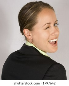 A business woman is giving a funky wink.
