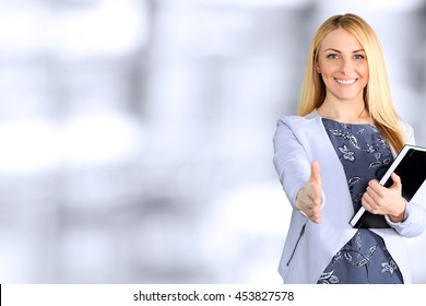 Business woman giving a hand/ handshake  in the office