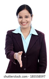 Business woman giving hand shake against white background
