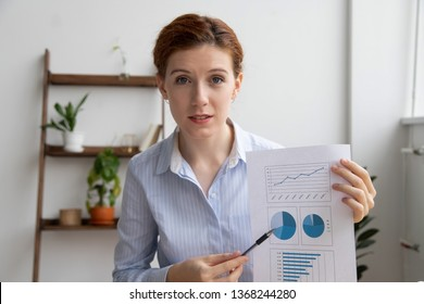 Business woman giving online presentation discuss financial report talking make conference video call, coach expert explain charts looking at webcam camera consulting client online shoot vlog webinar