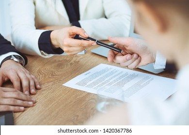 Business woman giving pen to businessman ready to sign contract. Success communication at meeting or negotiation