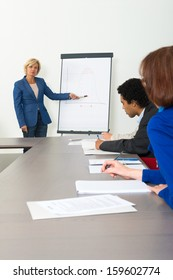 Business woman giving a presentation in a conference room