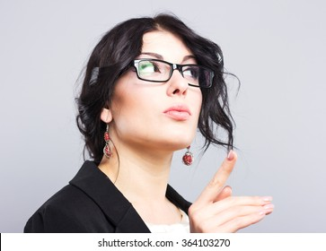 Business woman with glasses thinking. Beautiful woman in glasses. Glasses in a black frame. The face of a beautiful girl.Copy space.