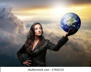 a business woman with a globe
