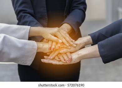 Business woman and Group of  Hands together Joining with success Concept with soft focus