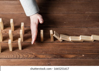 Business woman hand block domino effect. Business risk management and stabilisation situation. Life insurance company presentation with wooden blocks on table. Protection from economic crisis.