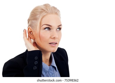 Business woman with hand to ear listening over white