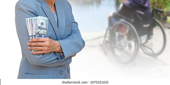 Business woman hand holding passport and American dollar currency isolated on blurred background patient sitting on wheelchair, travel insurance concept.