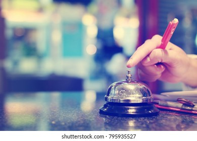 Business woman hand ringing the bell for assistance