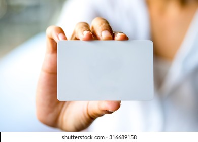 Business woman hand showing business card.