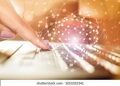 business woman hand typing on computer laptop with technology connection and internet of things,social media concept background