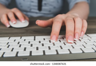 business woman hand typing on keyboard with mouse