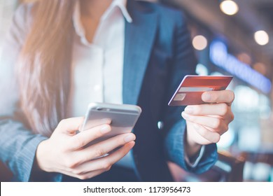 Business woman hand use credit cards and smartphones.