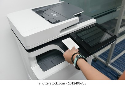 Copier images stock photos vectors shutterstock business woman hand is using smart card with printer to printing document reheart Image collections
