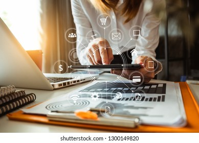 business woman hand working with laptop computer, tablet and smart phone in office with digital marketing media  in virtual icon at  office in morning light
