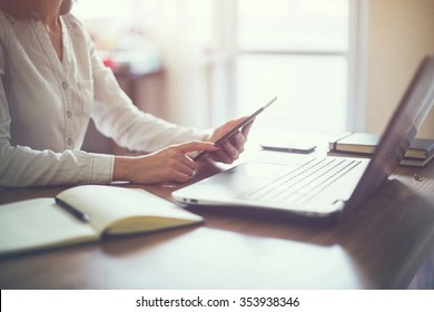 business woman hand working laptop computer on wooden desk