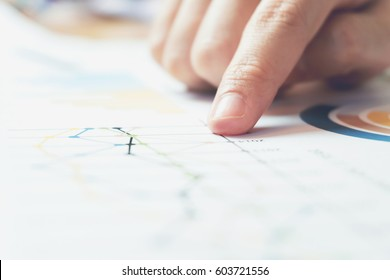 business woman hand working on wooden desk in office and there are many documents, graphs. Can be attributed to financial articles.