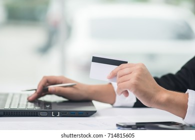 Business woman hands holding credit card and using laptop for online shopping. Online shopping concept.
