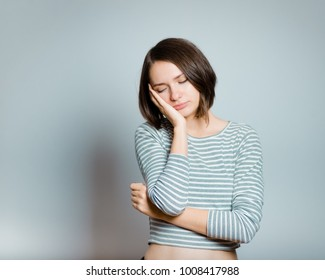 business woman has pain in temples, headache, migraine, isolated on background, studio photo