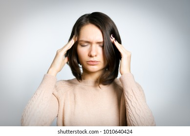 business woman has pain in temples, blood pressure, hypertension, isolated on background, studio photo