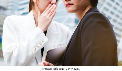 Business Woman have secret . She telling to your boss woman. Boss heard from business. Boss feel serious. Gossip and Secret concept