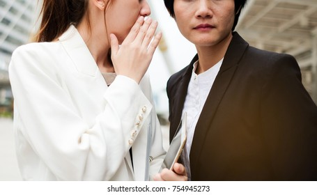 Business Woman have secret . She telling to your boss woman. Boss heard from business. Boss feel serious. Gossip and Secret concept.
